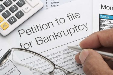 who pays for bankruptcies
